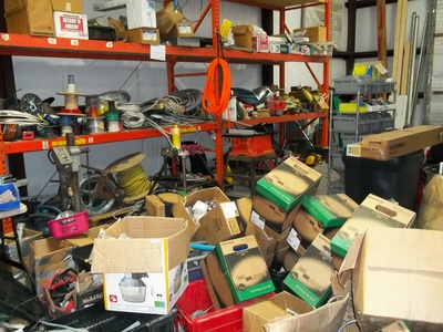 This warehouse needed some serious downsizing.  This before picture shows a cluttered and unusable space.