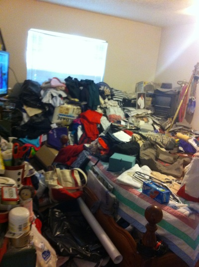 In order to organize your home you must first declutter.  This hoarding situation before looked scary.