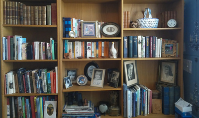 This decluttered bookshelf is inviting and nice to look at.
