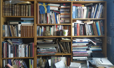 Bookshelves getting overrun?  Check out this cluttered bookshelf before.