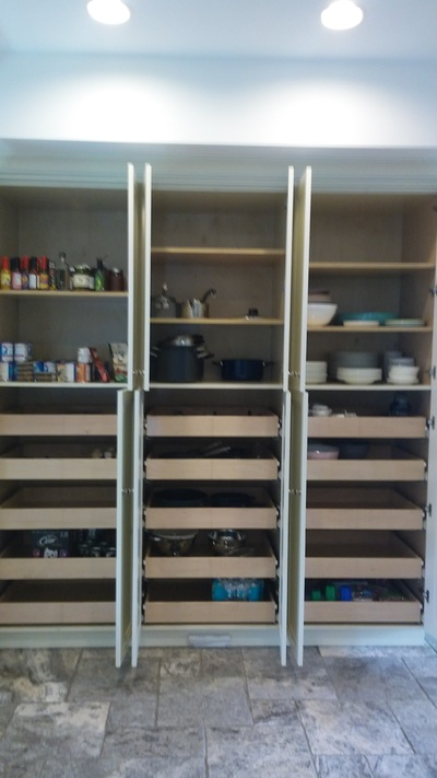 This after picture shows a new way to use the pantry.  Putting dishes and pots and pans makes this space more functional.