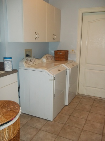 In no time at all this laundry room is organized and streamlined.