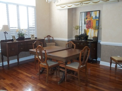 After decluttering and packing up this dining room it is now staged and ready to be sold!