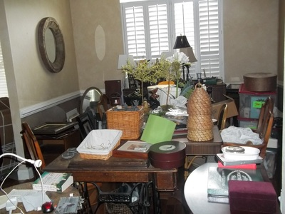 Decluttering and downsizing a dining room before image.